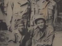 Stanley Hamamura, Fred Hosokawa, Seiji Kimura, and H. Hiyane in bivouac area in Italy. [Courtesy of Fumie Hamamura]