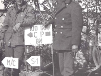 Kungo Iwai and Eo Ikum standing at the 100th Bn. Camp sign in Leghorn, Italy. [Courtesy of Fumie Hamamura]