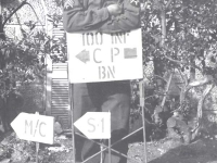 Tom Nosse standing at the 100th Bn. Camp sign in Leghorn, Italy. [Courtesy of Fumie Hamamura]