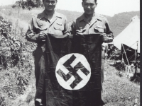 Two soldier hold the nazi flag. [Courtesy of Fumie Hamamura]