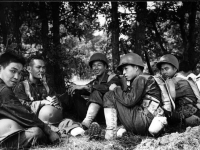 Morihara, Miyashiro, Grennie, Takahashi, Hirokawa, and Himura resting after a hike at Camp McCoy, July 1942 [Courtesy of Fumie Hamamura]