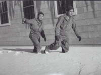 Soldiers walk through the first snowfall, Camp McCoy, November 1942. [Courtesy of Fumie Hamamura]
