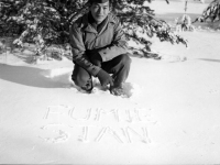 Stanley Hamamura writes his and Fumie's name in the first snowfall at Camp McCoy, Wisconsin [Courtesy of Fumie Hamamura]