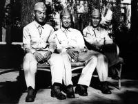 Stanley Hamamura, Itsuo Takahashi, and Isauis Inouye wait for the bus to Wisconsin Dells, 1942 [Courtesy of Fumie Hamamura]