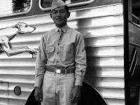 Stanley Hamamura in front of greyhound bus [Courtesy of Fumie Hamamura]