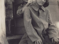 Stanley Hamamura gives a soldier a haircut. [Courtesy of Fumie Hamamura]