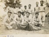 McCoy '43. E Co. Rear left to right: 1. Fujiyama, Takeo (KIA); 2. Moriki, Thomas; 3. Yamakawa, Sueyoshi; 4. no name; 5. Kumabe, Noboru; 6. Harada, Ken; 7. Morimoto, Ben. Front: 1. Furukido, Ken (KIA); 2. Hayashi, Shizuya; Yui, Kaname; 4. Kikuta, Toshie; 5. Kuromoto, Pete. (Courtesy of Joyce Walters)