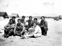 Soldiers pose with a Red Cross volunteer in Ghedi, Italy, June 1945 [Courtesy of Carol Inafuku] Inscription: Reverse: Thedi (Ghedi)June 1945