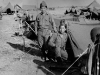 James Inafuku standing next to his tent with his neighbor, Ghedi, Italy, June 1945 [Courtesy of Carol Inafuku] Inscription:Reverse: thedi  (Ghedi) June 1945
