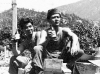 Two soldiers sit on rations and drink beer in Lecco, July, 1945 [Courtesy of Carol Inafuku] Inscription: Lecco July 1945