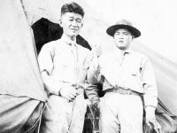 James & Kajoika in front of a tent at Schofield Barracks, Hawaii [Courtesy of Alexandra Nakamura]