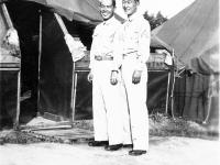 Yasuo Takata, James Kawashime in front of tents at Camp McCoy, Wisconsin [Courtesy of Alexandra Nakamura] Inscription: Tent Mate, Sgt. Takata