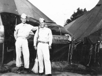 Yukio Yokota & Yasuo Takata in front of tents in camp. [Courtesy of Alexandra Nakamura]