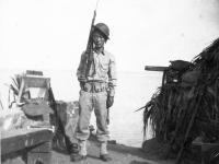 James Kawashima standing with rifle on his shoulder in at Wailea Point, Hawaii [Courtesy of Alexandra Nakamura]
