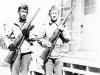 James Kawashima & Yukio Yokota standing with rifles in hand at Camp McCoy, Wisconsin [Courtesy of Alexandra Nakamura]