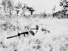 James Kawashima with his rifle in a grassy field. [Courtesy of Alexandra Nakamura]