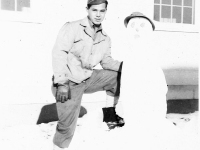100th Battalion soldier with a snowman at Camp McCoy, Wisconsin [Courtesy of Sonsei Nakamura]