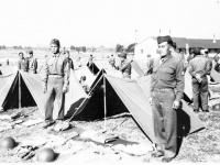 Yeiki Kobashigawa & Sonsei Nakamura on the side of a tent at Camp McCoy, Wisconsin [Courtesy of Sonsei Nakamura]