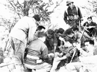 Group of soldiers sitting and 'shootin craps' [Courtesy of Sonsei Nakamura]