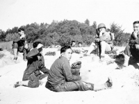 Uchida, Ogata, Tani, Nakamura sitting on the ground resting [Courtesy of Sonsei Nakamura]