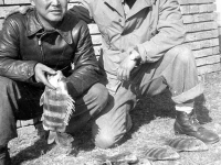 Ishii and Ono with their catch from Mississippi, November 1942 [Courtesy of Leslie Taniyama] Inscription: Reverse: Nov. 1942 Lt. Ishii - Cook. & yours truly T. Ono. Dec 31/1942