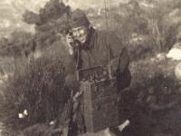 """Yozo """"Rocky"""" Yamamoto using the field phone. [Courtesy of Mrs. William Takaezu]"""