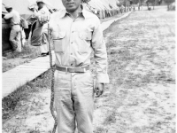Tadao Hodai poses with snake at Camp Shelby, Mississippi. [Courtesy of Mrs. William Takaezu]