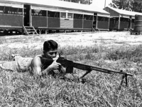 William Takaezu practicing with a rifle on Ship Island, Mississippi. [Courtesy of Mrs. William Takaezu]
