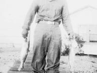 William Takaezu with trout on Cat Island, Mississippi. [Courtesy of Mrs. William Takaezu]
