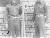 Lieutenants Kenneth Tanaka and Rocco Marzano with the day's cat on Cat Island, Mississippi. [Courtesy of Mrs. William Takaezu]