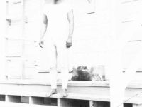 William Takaezu in front of cabin on Ship Island, Mississippi. [Courtesy of Mrs. William Takaezu]