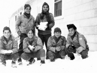 Company B with snow at Camp McCoy, Wisconsin. [Courtesy of Mrs. William Takaezu]