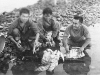 Soldiers with sheepshead at Cat Island, Mississippi. [Courtesy of Mrs. William Takaezu]