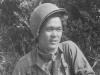 Kawakami posing with gun. . [Courtesy of Mrs. William Takaezu]