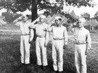 Men saluting at Camp McCoy, Wisconsin (Courtesy of Alvin Tsukayama)