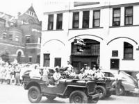 Victory Parade in La Crosse, Wisconsin. Inscription: Victory Parade (Courtesy of Alvin Tsukayama)