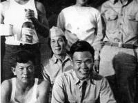 Soldiers sharing wine at Camp Shelby [Courtesy of Ukichi Wozumi]