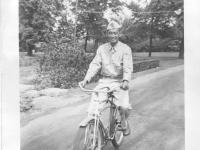 Sam Tomai bike riding on campus at University of Wisconsin, Madison [Courtesy of Sandy Tomai Erlandson]
