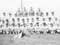 The 100th Battalion had a baseball team which competed against top teams in the state while stationed at Camp McCoy, Wisconsin. Team members and officers in this September 1942 photo are: front row L-R, Haruo Hayakawa, Yozo Yamamoto, Masaharu Takeba, Fred Wada, Wataru Kaneshina, Masahiko Miyagi, Yoshinao Omiya, Shunji Suzuki, Tadashi Ohta, Shigeo Igarashi. Second row L-R, Edward Mitsukado, Seiji Tanigawa, Shigeo Takata, Moichi Okazaki, Kenneth Kaneko, Toshio Mizusawa, Goro Moriguchi, Masaru Yamamoto, Hide Yamashita, Tadashi Matsunami, Ted Hirayama. Third row L-R, John Y.Yamada, Koichi Fukuda, Sam Tomai, Ronald Hamamura, Akira Akimoto, Al Nozaki, Henry Shiyama, Fumi Taniyama, Tadao Honbo, Mits Omori. Back row L-R, Capt. Katsumi Kometani, Col. Farrant Turner, Maj. James Lovell, Capt. Kiyoshi Kuramoto. (Courtesy of Sandy Tomai Erlandson)