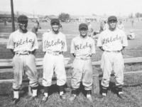 Infielder members of the Aloha team.  Yamamoto on 3rd Base, Tomai as short stop, Miyagi on 2nd base, and Yamada on 1st. [Courtesy of Sandy Tomai Erlandson]