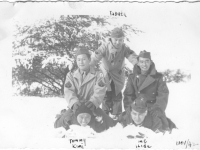 (Clockwise from left) Kumi, Tommy, Tabata, Sam Tomai, and Hide play in the snow at Camp McCoy, Wisconsin, November 1942 [Courtesy of Sandy Tomai Erlandson]
