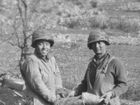 Holding remants of shell.  Left - Conrad Tsukayama.  Right - Kazuo Mizuno. Kauai boys.  [Courtesy of Herbert Sueoka]