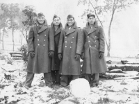 Camp McCoy Sept 26,, 1942.  Just before leaving for Madison. A. Sahara, Me, T. Ibaraki, T. Okumura. Notice snowball in front. [Courtesy of Leslie Taniyama]