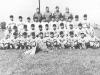 100th Infantry Ball Team - 1st Row  - Mascot, Yozo Yamamoto, Masa Takeba, Dan Ivada, Kaneshima, M. Miyagi, Y. Omiya, S. Suzuki. [Courtesy of Leslie Taniyama]