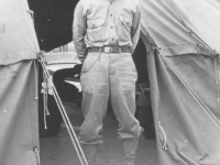 Tom Matsumura stands in front of his tent at Camp McCoy, Wisconsin. [Courtesy of Florence Matsumura]