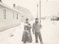 Toshiro Morishige (left) with a friend during the first snow storm of the year at Camp McCoy, Wisconsin. [Courtesy of Morishige Family]