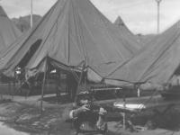 """Joe Nakahara kids around in """"tent city"""" at Camp McCoy, Wisconsin, 1942. [Courtesy of Velma Nakahara]"""