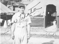 Joe Takata in his Aloha baseball uniform at Camp McCoy, Wisconsin, 1942. [Courtesy of Velma Nakahara]