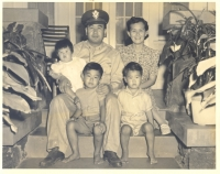 Katsumi Kometani with his family in May 1942, the day he left for Camp McCoy, Wisconsin. [Courtesy of Dorothy Kometani]