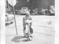 Yozo Yamamoto drinking at a water fountain while on furlough in Madison, Wisconsin [Courtesy of Sandy Erlandson]